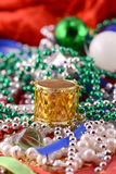 Christmas decorations, new year invitation card, drums, pearls and balls Royalty Free Stock Photos