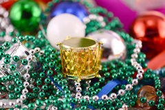 Christmas decorations, new year invitation card, drums, pearls and xmas balls Royalty Free Stock Photo