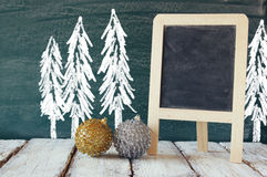 christmas decorations next to empty blackboard Royalty Free Stock Image