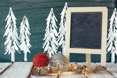 christmas decorations next to empty blackboard Stock Photo