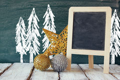 christmas decorations next to empty blackboard Royalty Free Stock Photography