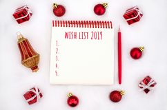 Christmas decorations and notebook with wish list. stock image