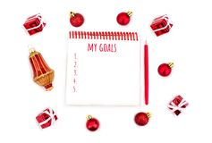 Christmas decorations and notebook with wish list. royalty free stock photography