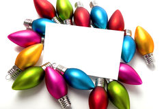 Christmas Decorations Notecard. A blank notecard surronded by Christmas decoration or baubles on a white background, add copy or graphic Royalty Free Stock Images