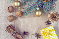 Christmas decorations, nuts and spices with a blank paper Stock Photography