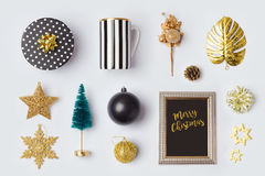 Christmas decorations and objects in black and gold for mock up template design.View from above. Flat lay Stock Photo