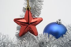 Christmas decorations objects. Red star and blue ball Stock Photo