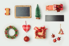Christmas decorations and objects for mock up template design. Chalkboard, toy truck and wreath. View from above. Flat lay royalty free stock photos