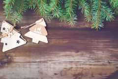 Christmas background 2018. Christmas decorations on old dark boards. Christmas background. New Year background. Xmax background. Christmas tree. Toned image Royalty Free Stock Photo