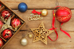 Christmas decorations on old rustic wood Stock Images