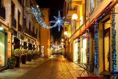 Christmas decorations in Old Town of Alba, Italy. stock photo