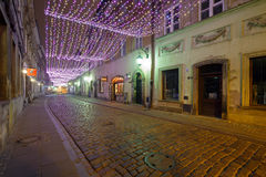 Christmas decorations in the Old Town in Warsaw at night Royalty Free Stock Photos