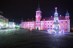Christmas decorations on the old town of Warsaw at night.Royal C Stock Photos