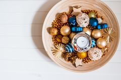 Christmas decorations on old wooden shabby plate with copy space for text. Home decoration elements with candle for royalty free stock photos