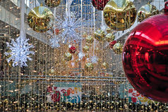 Christmas decorations. In one shopping mall with red and gold balls and thousands of Christmas lights Royalty Free Stock Photo
