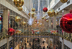 Christmas decorations. In one shopping mall with red and gold balls and thousands of Christmas lights Royalty Free Stock Photos