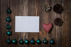 Christmas decorations ornament. Christmas decorations ornament - Christmas balls, pinecone and heart on wooden background. Copyspace Royalty Free Stock Photo