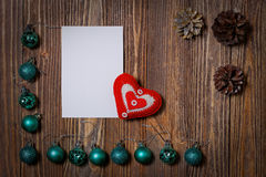 Christmas decorations ornament. Christmas decorations ornament - Christmas balls, pinecone and heart on wooden background. Copyspace Royalty Free Stock Images