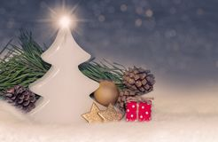 Christmas decorations, ornaments with bauble, tree shaped candle, gift stock image