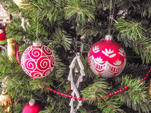 Christmas decorations. Christmas ornaments in a Christmas tree Royalty Free Stock Photos