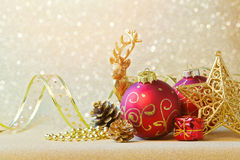 Christmas decorations over glitter sparkle background Stock Photos