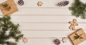 Christmas decorations over white wood board. Space for text Stock Photos