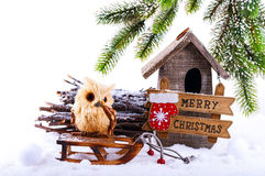 Christmas decorations: owl and birdhouse Stock Images