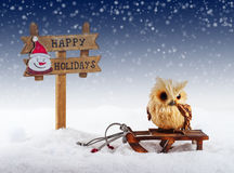 Christmas decorations: owl and signboard Stock Photo