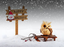 Christmas decorations: owl and signboard Royalty Free Stock Photography