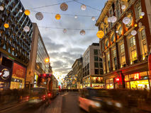 Christmas decorations on Oxford Street, London, at night. Royalty Free Stock Photography
