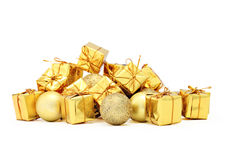 Christmas decorations packages and golden balls. On white table Royalty Free Stock Photos