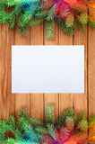Christmas decorations. With paper blank at wooden background Royalty Free Stock Photo