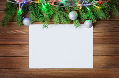 Christmas decorations. With paper blank at wooden background Stock Images