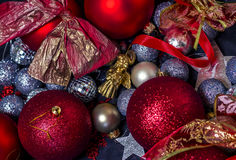 Christmas decorations. Photography of red and silver Christmas balls. Close-up image with Christmas decorations - background Royalty Free Stock Photography