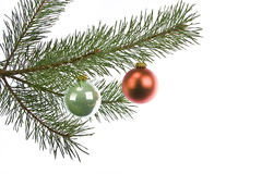 Christmas decorations on pine branch isolated Royalty Free Stock Photo