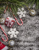Christmas decorations with pine branches on  wooden table covered with snow top view Royalty Free Stock Photography