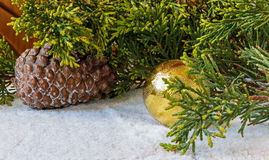 Christmas decorations, pine cones and Christmas tree branch in t Stock Photos