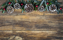 Christmas decorations with pine cones, fir tree branches and red balls Royalty Free Stock Photos