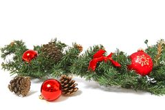 Christmas decorations and pine cones isolated on white backgroun Stock Photo