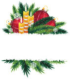 Christmas decorations and pine tree branches. Red baubles, candles and pine branches. Christmas composition with place for text Royalty Free Stock Photo