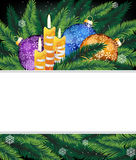Christmas decorations and pine tree branches. Purple, blue and orange Christmas balls, candles and pine branches. Christmas background with place for text Royalty Free Stock Image