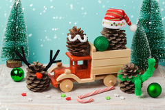 Christmas decorations with pinecorns in a toy truck royalty free stock image
