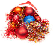 Christmas decorations pour out from red santa hat Royalty Free Stock Photo