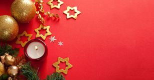 Christmas decorations on red background with copy space for text Royalty Free Stock Photo
