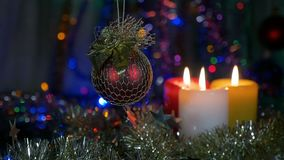 Christmas decorations, red ball. Blurred beautiful background with flashing lights. Movement of the camera around the. Object. HD stock video footage