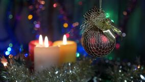 Christmas decorations, red ball. Blurred beautiful background with flashing lights. Movement of the camera around the. Object. HD stock footage