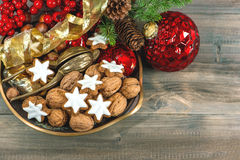 Christmas decorations red baubles and cinnamon cookies Stock Image