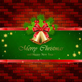 Christmas decorations with red bow on brick wall Stock Photo