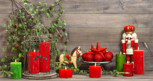 Christmas decorations with red candles and vintage toys Royalty Free Stock Photos