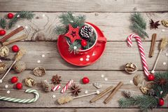 Christmas decorations in red cup on wooden background royalty free stock image